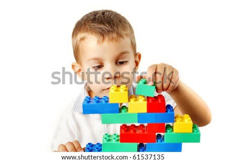 Child playing with construction plastic bricks