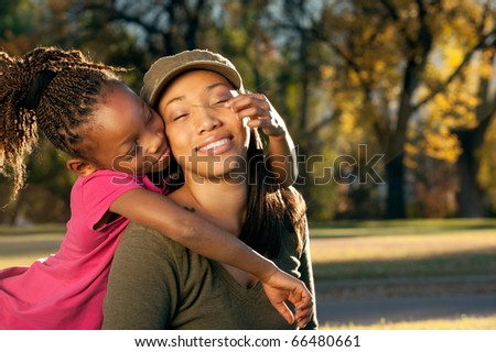 Child playing with mother