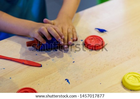 Child playing with plasticine. Craft games. Games for children. #1457017877