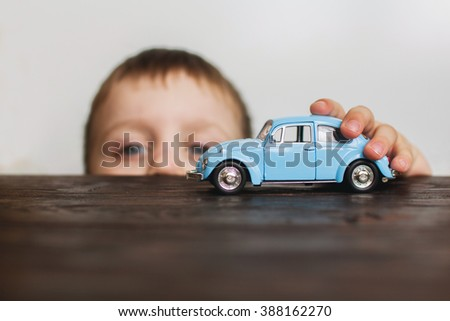 child playing with the car close