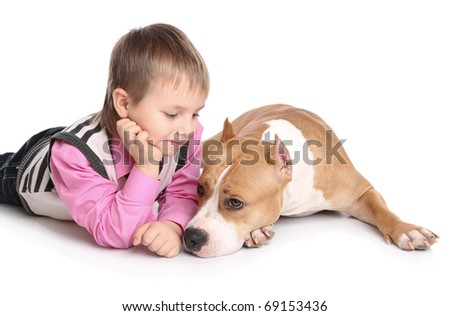 child playing with the dog. Isolated at white background - stock photo