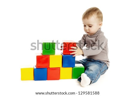 child playing with toy cubes, isolated on white