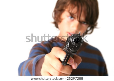 child pointing gun at camera. young boy with firearm weapon