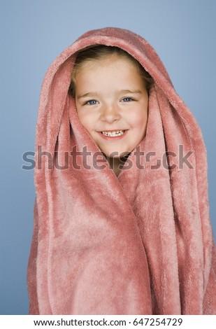 Child posing draped in towel #647254729
