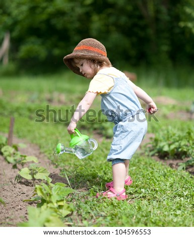 Child pours vegetable patch