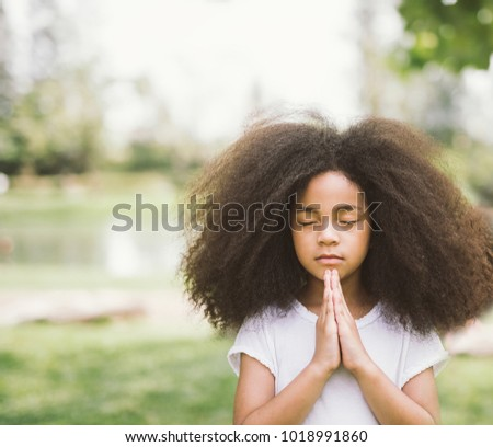 child praying. girl kid prays. Gesture of faith.Hands folded in prayer concept for faith,spirituality and religion #1018991860