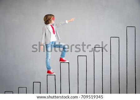 Child pretend to be businessman. Child rising up drawn chart bar. Imagination, idea and success concept. Back to school