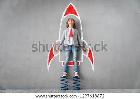 Child pretend to be businessman. Smart kid in class. Imagination, idea and success concept