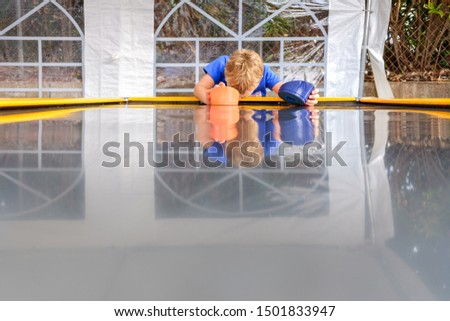 Child prostrated after losing a game.