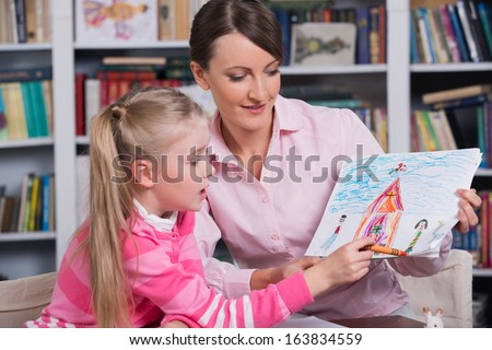 Child psychologist with a little girl, a child draws
