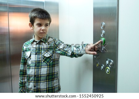 Child pushed a button in an elevator. #1552450925