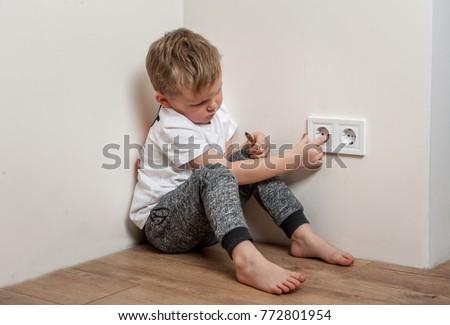child put finger in socket. ...