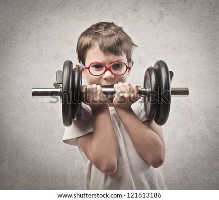 Child raising a dumbbell