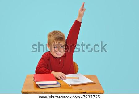 Child raising hand at school