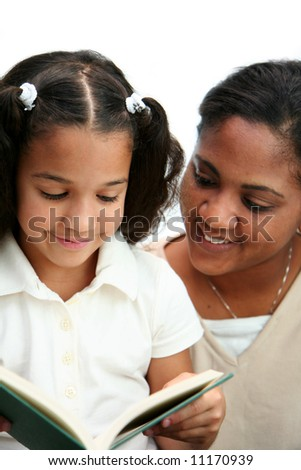 Child reading a book with her teacher