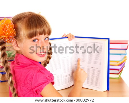 Child reading open  book on table. Isolated.