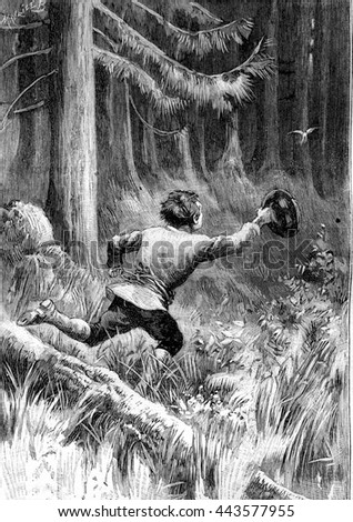 child running after a bird in...