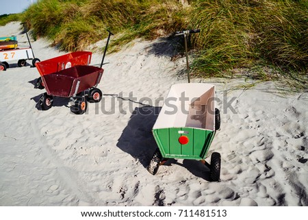 Child's beach handcart at the beach - Shutterstock ID 711481513