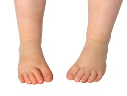 Child's feet isolated on white
