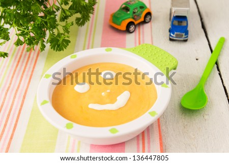 Child`s food: cream soup from marrow and potato