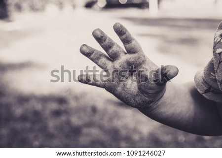 Child's hand dirty playing close up black and white sepia vintage macro #1091246027