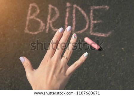 child's hand draws hearts, drawings chalk on asphalt #1107660671
