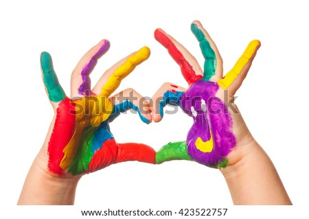 Child's hand painted watercolor in heart shape against white background