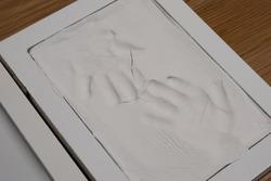 Child's handprints in plaster cast. Home.