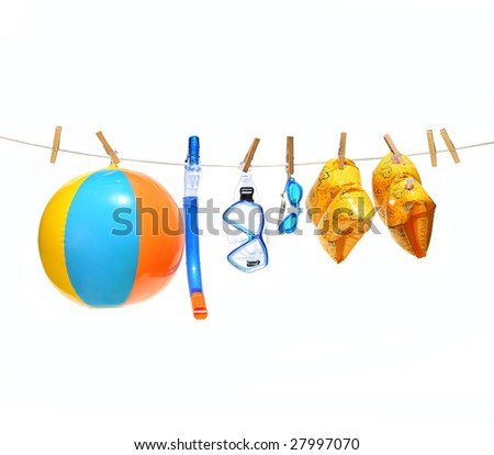 Child's pools toys with clothesline on white background