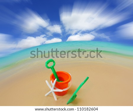 child's sand bucket at the beach