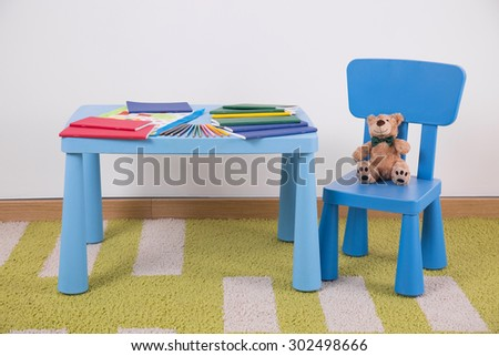 Child\'s space for study with small blue furniture
