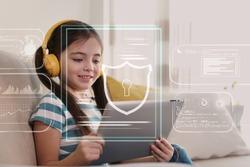 Child safety online. Little girl using tablet at home. Illustration of internet blocking app on foreground