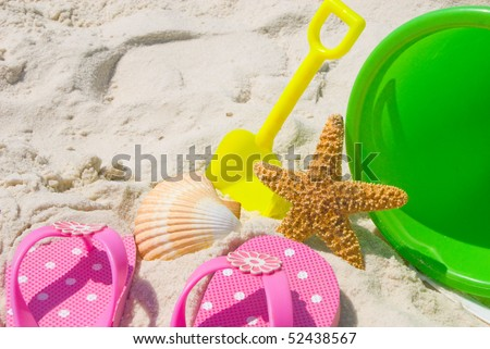 Child sandals and toys at beach
