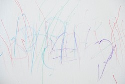 Child scribble on the wall colored pencils scribbles on a white wall made by a little kid that could pass as abstract work.