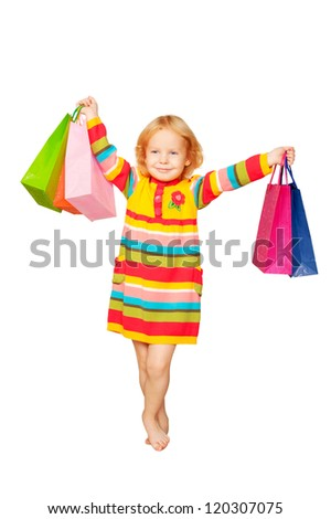 Child shopping. Happy fashion little blond girl with shopping bags. Space for your logo or symbol. Isolated on white background