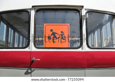 Child sign in rear bus window