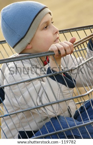 Child sitting in a trolley