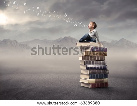 Child sitting on a stack of books with letters coming out of his mouth - stock photo