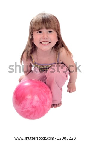 Child sitting on floor holding ball isolated on white