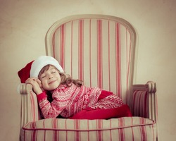 Child sleeping at home. Christmas dream. Xmas holiday concept
