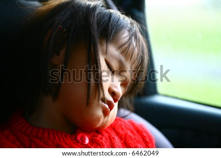 child sleeping in a car , close up picture on the head and face