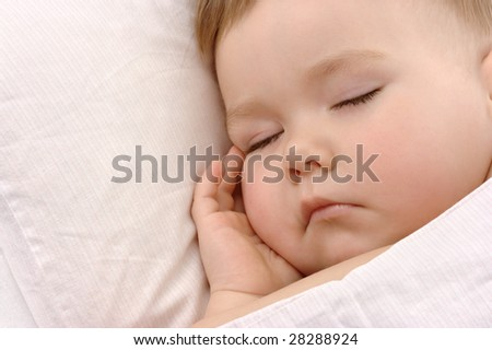 Child sleeping with hand under his cheek, high key portered