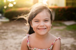 child smiling in a beautiful sunset
