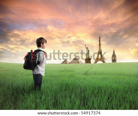 Child standing on a green meadow with landmarks from diverse cities on the background