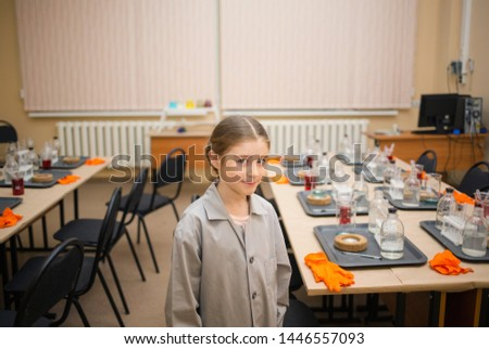 child student in the chemistry room. exciting experiments and experiences for children. cognitive science and development.