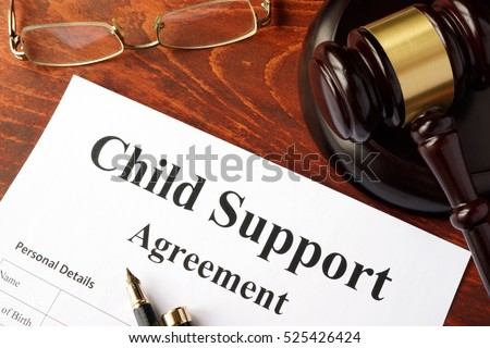 Child support agreement on an office table. #525426424