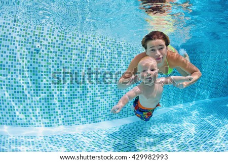 Child swimming lesson - baby with mother learn to swim, dive underwater in swimming pool. Healthy active family lifestyle, physical exercise, water sport activity, fun with parents on summer vacation.