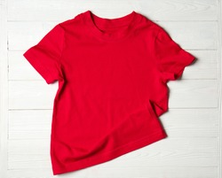 Child t-shirt on white wooden background