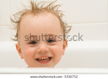 Child taking a bath, funny hairstyle