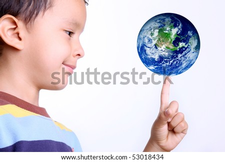child taking the earth on his finger with a gesture of happiness